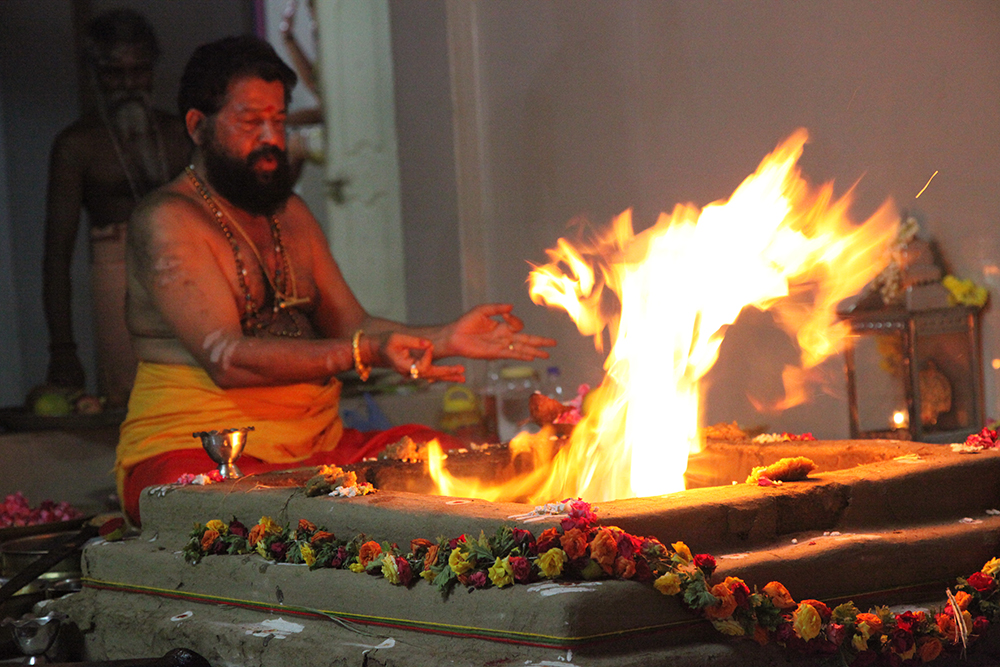 A Hindu Priest Performing Mangal Dosha Puja